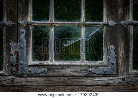 The window of an old wooden farmhouse.