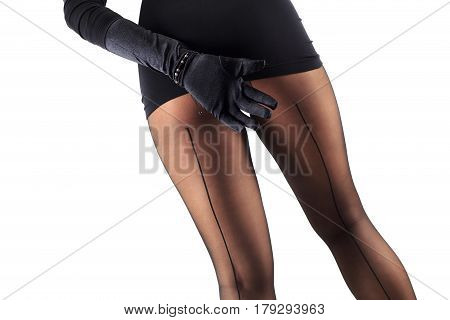 Sexy female legs in beautiful stylish stockings and high heels shoes black gloves and dress isolated on white background horizontal view with copy space
