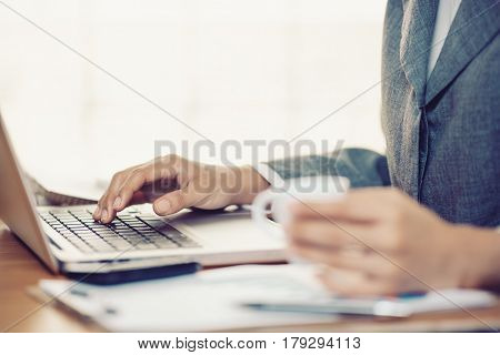 Woman hands typing in a laptop in office