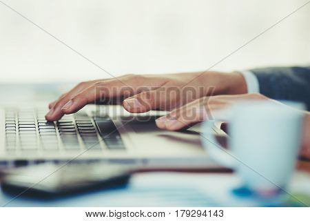 Woman in office and working on her laptop