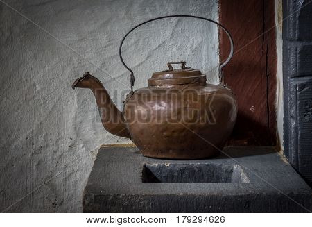 The Old And Ancient Kettle On A Stove