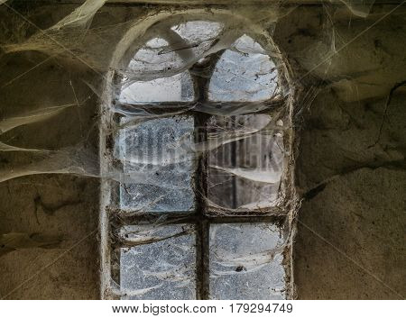 The  Window With Cobwebs Of An Old Farmhouse