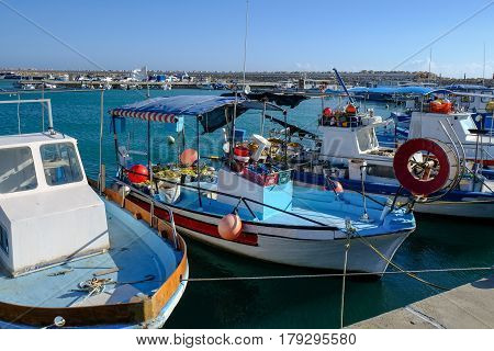Fishing boats moored at the marina in the fishing village of Zygi in Cyprus.  Taken in spring on a bright sunnny day.