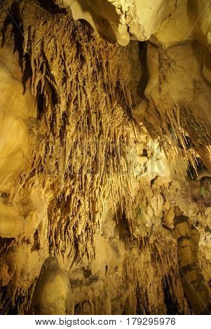 Stalactites and stalagmites formations in the cave near Avignon, France