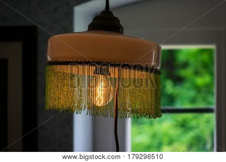 Lighting Light Bulb With Lampshade In A Room