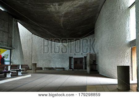 RONCHAMP, FRANCE - APRIL 23, 2016: Interior of Pilgrimage Church of Notre Dame du Haut in Ronchamp. The architect is Le Corbusier. Franche-Comte, France.