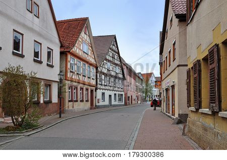 WEIL DER STADT, GERMANY - April 17, 2015: Old street with half-timbered houses in perspective. Baden-Wurttemberg.