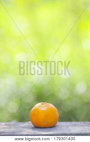 Orange Fruit And Slice On Wooden And Green Background, Selective Focus Shallow Dof.