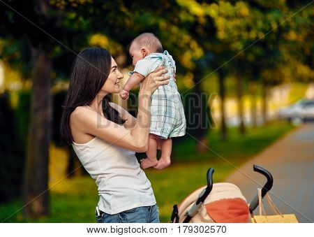 Young woman with her newborn baby enjoying summer day