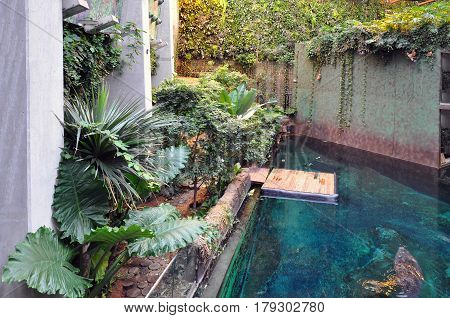WROCLAW, POLAND - OCTOBER 14, 2015: Interior of the modern zoo stylized to Africa with artificial pool and many plants.