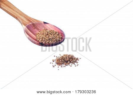 Fenugreek Seeds On A Brass Spoon Isolated On A White Background.