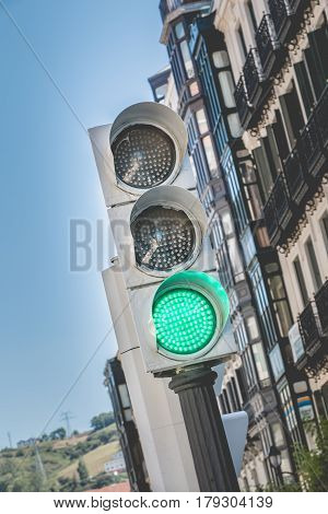 Spain traffic light shows green light for pedestrians