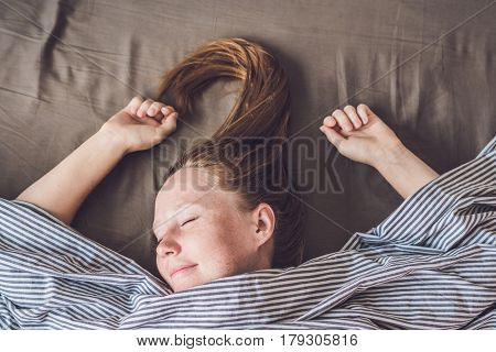 Beautiful Young Woman Lying Down In Bed And Sleeping, Top View. Do Not Get Enough Sleep Concept