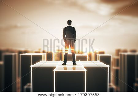 Back view of businessman standing on top of building in abstract amber town. 3D Rendering
