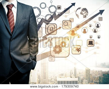 Man in suit with abstract digital business charts globe arrows HR and other icons on city background