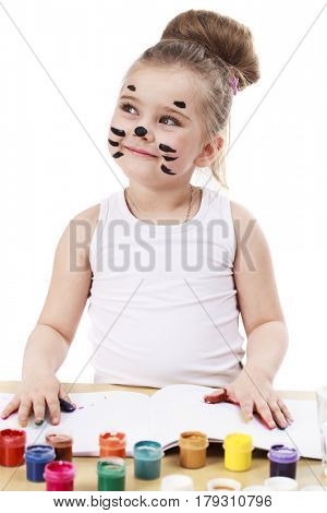 Children painted face. Happy beautiful little girl with painted face, isolated on white background