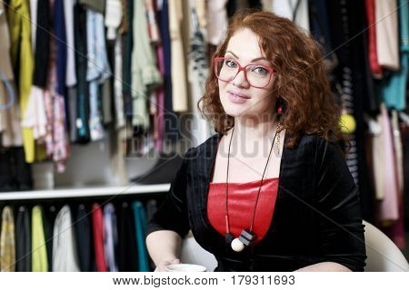 Stylish designer clothes in showroom