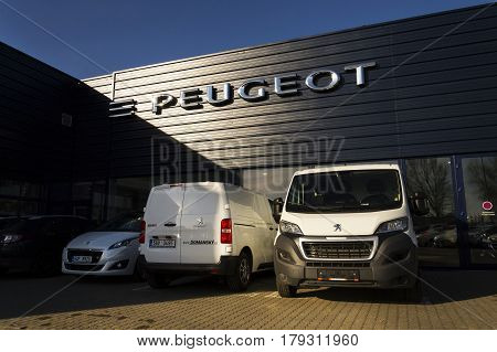 Prague, Czech Republic - March 31: Peugeot Car Company Logo In Front Of Dealership Building On March