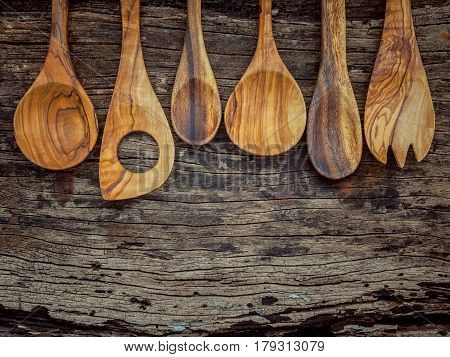 Various Wooden Cooking Utensils Border. Wooden Spoons And Wooden Spatula On Shabby Wooden Background