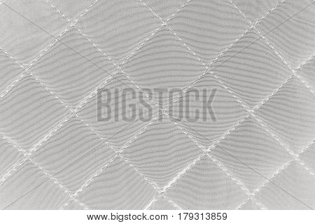 Quilted Synthetic Fabric Texture Background.