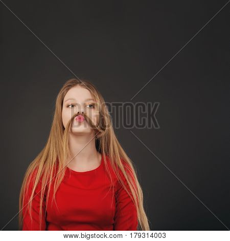 Cool Young Blonde Caucasian Woman Making Mustache With Her Hair.