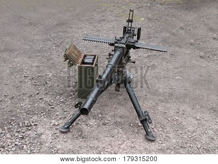A Vintage Military Machine Gun on a Tripod Stand.