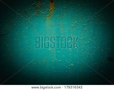 Abstract green texture with grunge cracks. Cracked paint on a metal surface. Bright urban background with rough paint transitions. The cracks grunge urban background.