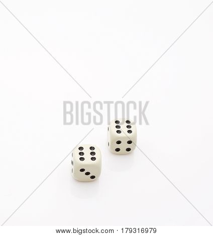 Two dice and number six double isolated on white background. A place for your text and images.
