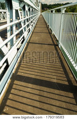 Footpath Part Of Deck Of The Menai Suspension Bridge Over Between Anglesey And Mainland Wales
