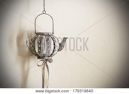 old vintage candle holder. Candlestickold vintage candle holder. Candlestick. Form teapot with ribbons