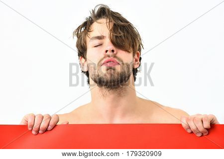 Bearded man short beard. Caucasian sexy topless athletic young amused macho with stylish beard and moustache holding red plank isolated on white background