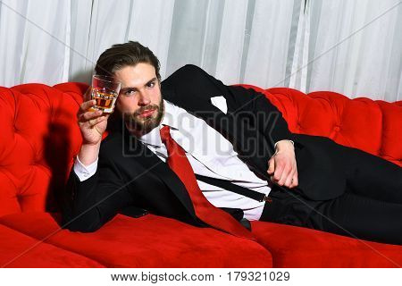 Bearded Man, Businessman Holding Glass Of Whiskey In Red Tie