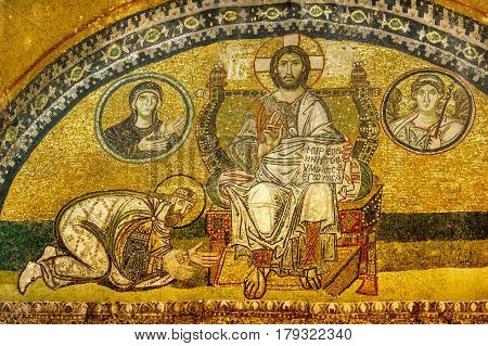 Hagia sofia. Mosaic in the imperial port. The Emperor kneels to Christ Pantokrator. In the book: Peace be with you I am the light. Maria is in the left medallion and the angel Gabriel in the right.