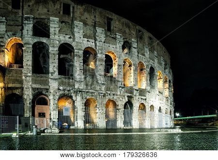 The Colosseum (Coliseum) at night in Rome, Italy