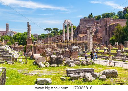 ROME - MAY 10, 2014: Ruins of the Roman Forum in Rome, Italy. The Roman Forum is an important monument of antiquity and is one of the main tourist attractions of Rome.