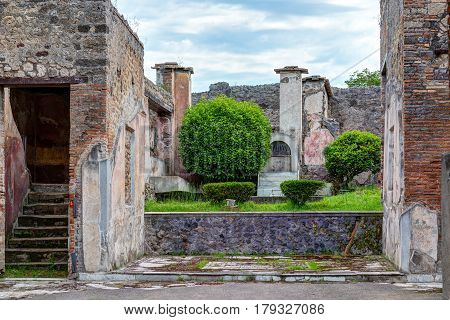 Ruins of a house in Pompeii, Italy. Pompeii is an ancient Roman city died from the eruption of Mount Vesuvius in 79 AD.