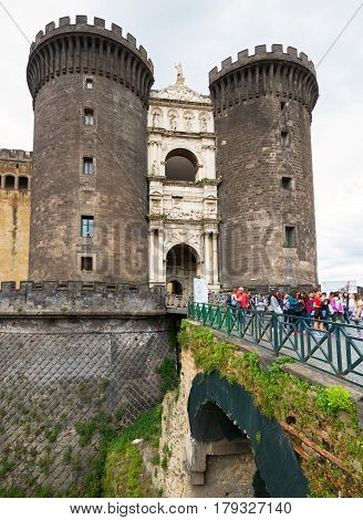NAPLES, ITALY - MAY 13, 2014: Tourists visit the Castel Nuovo seat of the medieval kings of Naples.