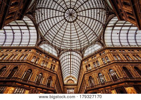 NAPLES, ITALY - MAY 13, 2014: Galleria Umberto I in Naples. Low angle view.