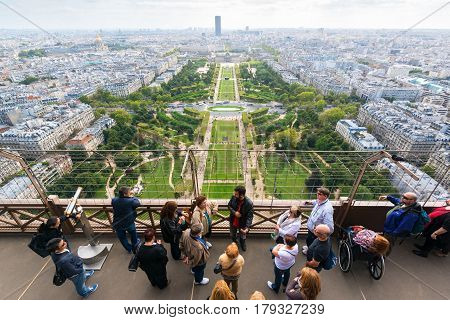 PARIS - SEPTEMBER 20, 2013: Tourists are on the observation deck of the Eiffel Tower. The Eiffel tower is one of the major tourist attractions of France.