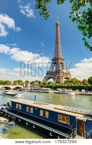 Residential barge and tourist ships on the Seine near the Eiffel Tower, Paris