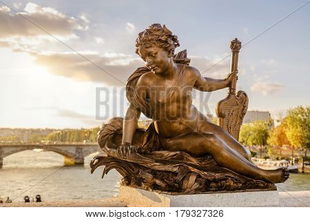 Statue of a nymph on the Pont Alexandre III in Paris, France. This bridge was named after russian Tsar Alexander III.