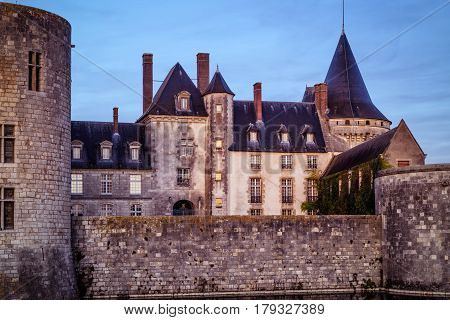 The chateau of Sully-sur-Loire in the evening, France. This castle is located in the Loire Valley, dates from the 14th century and is a prime example of medieval residence.