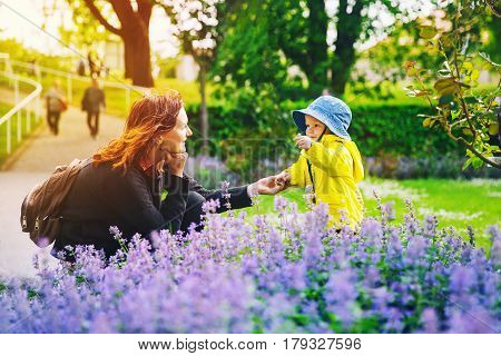 Beautiful Mother With Son In The Park In Spring Time.