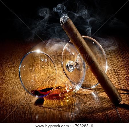 Cigar and almost empty glass of cognac
