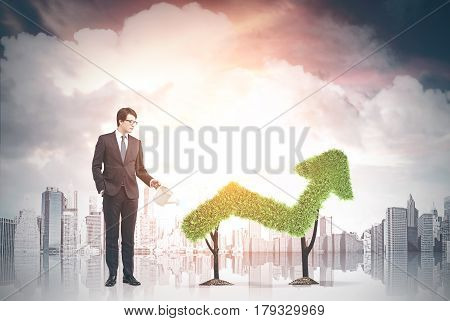 Businessman And Grass Graph In City