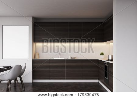 Dark Kitchen Counters And A Table