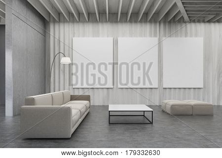 Living Room With Wooden Walls, Pictures And Sofa