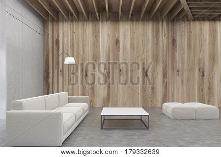 Living room interior with wooden walls a sofa a rectangular coffee table and two pouffes. 3d rendering mock up