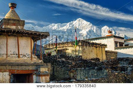 Old Buddhist stupa in the village of Kagbeni with Nilgiri North in the background Annapurna Circuit Trek Nepal