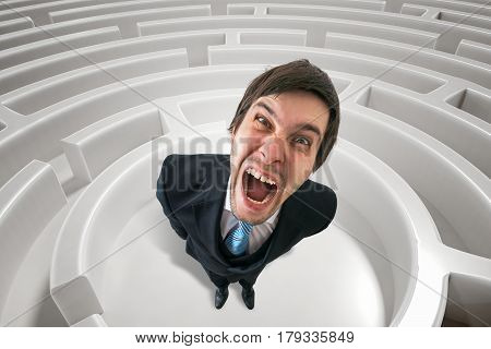 Frustrated Angry Man Is Lost In Maze. 3D Rendered Illustration O
